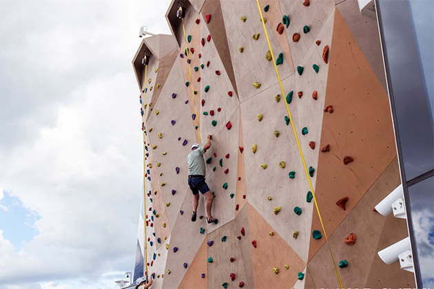 Passengers on Anthem's rock climbing wall
