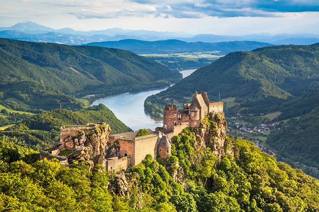 Beautiful landscape with Aggstein castle ruin and Danube river at sunset in Wachau, Austria
