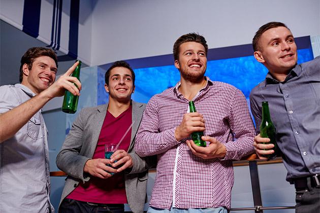 Four male friends enjoying drinks