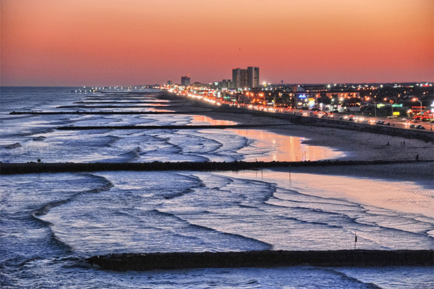 Galveston city skyline and coast at sunset