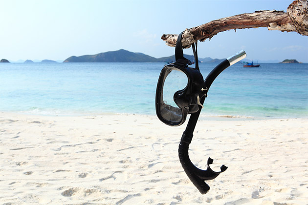 Snorkeling gear on a white sand beach