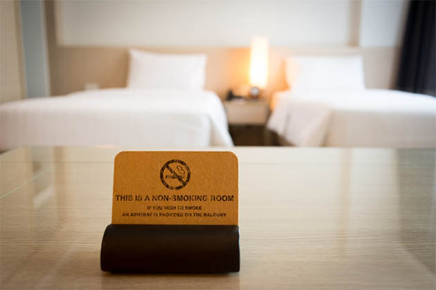 No smoking sign in bedroom