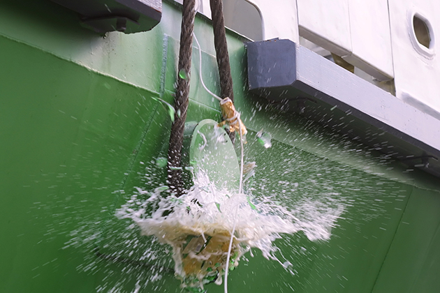 Champagne smashed against the bow of a ship