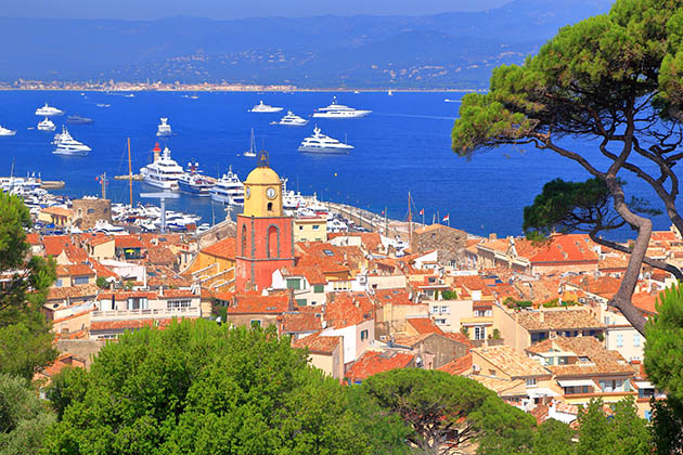 Aerial view to the old town and distant boats, Saint Tropez, French Riviera, France