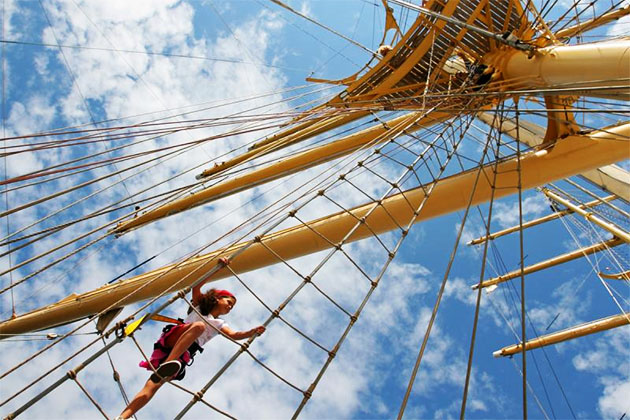 Adventurous teens can climb the mast on a Star Clippers cruise.