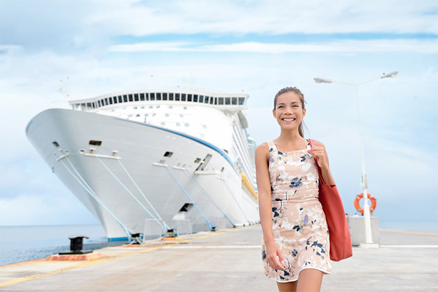 Young woman walking with cruise ship in the background