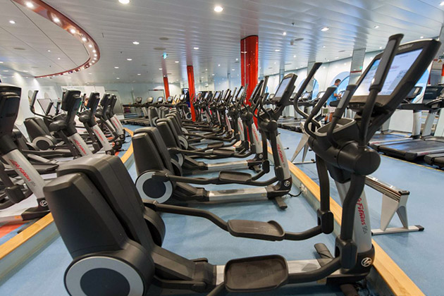 Row of elliptical machines on Allure of the Seas