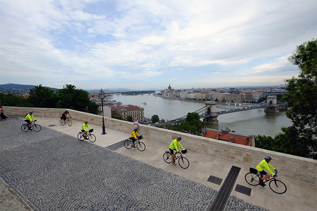 Group of people biking along a path in Europe