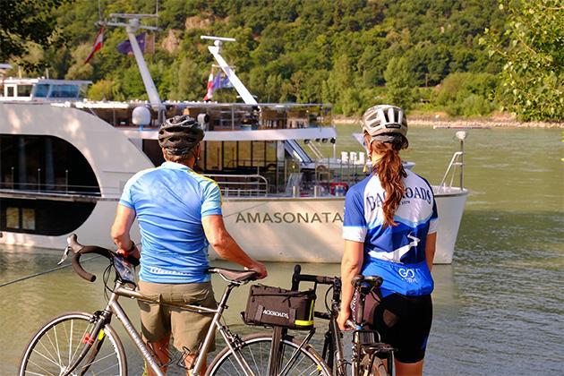 AmaSonata passengers parked with bikes along river
