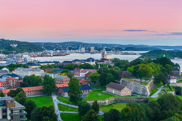 Oslo, Norway. A view at Oslofjord and Akershus fortress from the top of City hall (Radhuset) tower