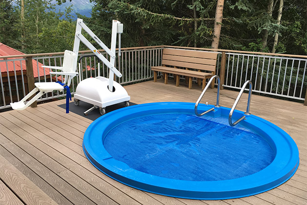 The ADA-compliant hot tub at the Princess Wilderness Lodge with a chair lift