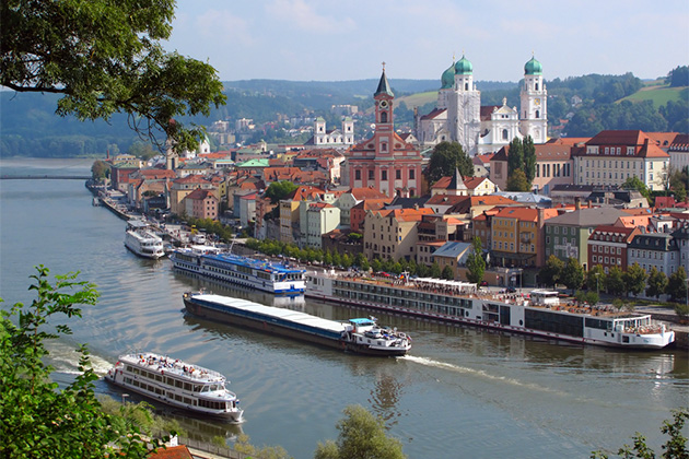 River cruise ships sailing in Passau, City of Three Rivers, Bavaria, Germany.