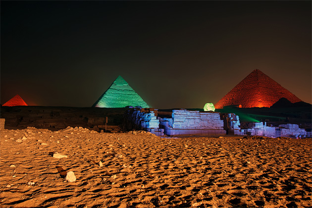 Giza pyramid and Sphinx light up for sound and light show, Cairo, Egypt.