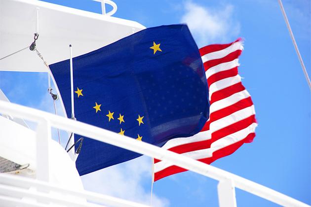 Alaskan and American flags waving from cruise ship, Juneau, Alaska