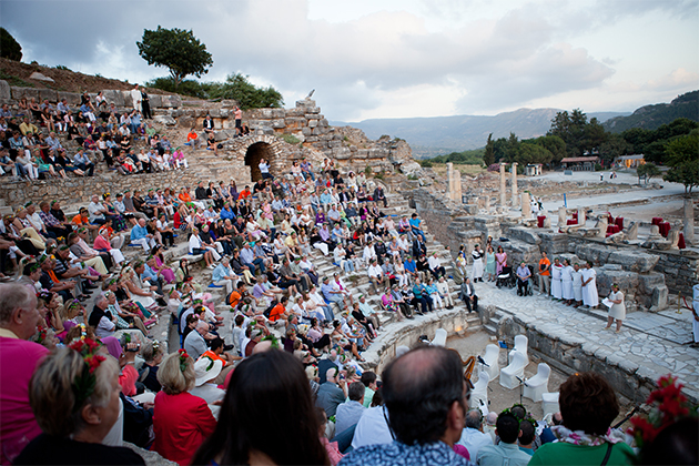 People gathered in an ancient amphitheater in Kusadasi for an AzAmazing Evening event