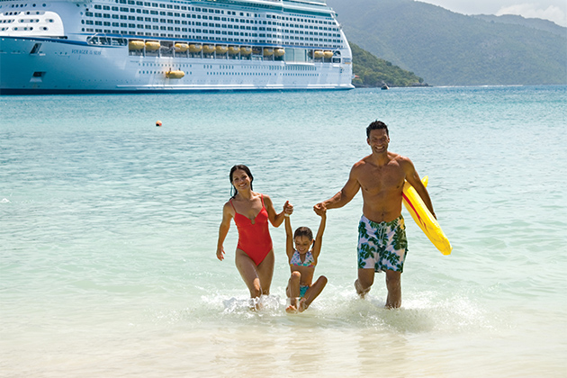 Family of three playing in the water while Royal Caribbean ship is in port