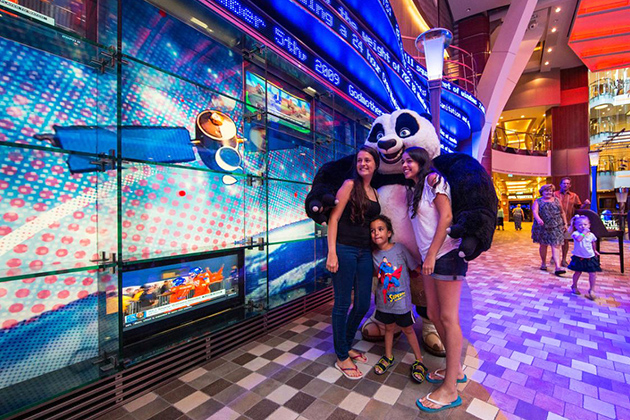 Kung Fu Panda posing with a family on Oasis of the Seas