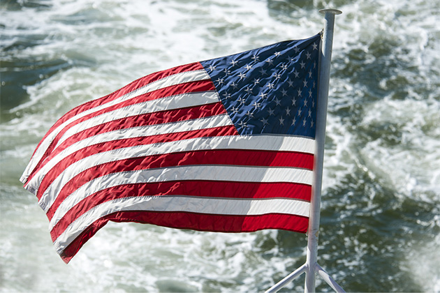 United States of America flag waving from a boat or cruise ship in the Hudson River