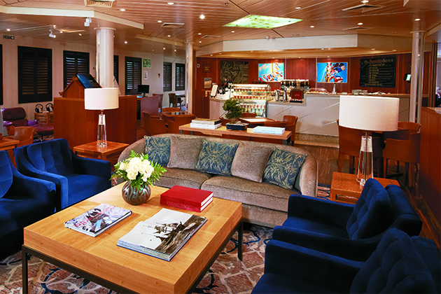 Interior of the Yacht Club on Windstar Cruises, with the coffee bar in the background