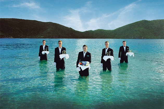 Seabourn butlers serving caviar and Champagne at the Caviar in the Surf event