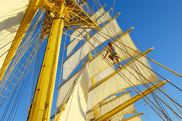 Passenger climbing the mast on a Star Clippers ship