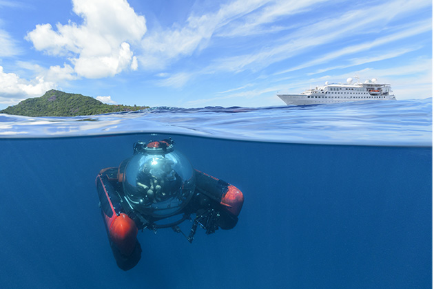 Partial underwater shot of Crystal's submarine, with Crystal Esprit on the water in the background
