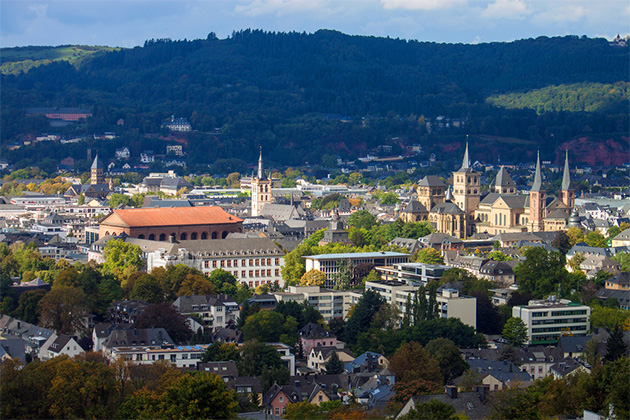 Aerial shot of several Medieval monuments (Cathedral of Saint Peter, Basilica of Constantine, St. Gangolf church and others) in Trier, Germany