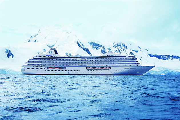 Exterior shot of Crystal Serenity with glaciers in the background