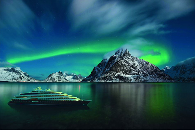 Rendering of Scenic Eclipse cruising Arctic waters at night, with the Northern Lights in the background