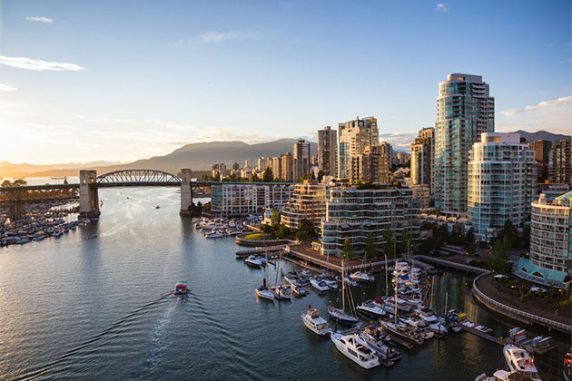 View of Downtown Vancouver and Burrard Bridge at False Creek during sunny sunset