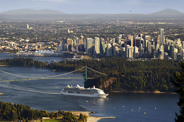 Cruise ship leaving Burrard Inlet (with Stanley Park, Lions Gate Bridge and the plane on the horizon) in Vancouver