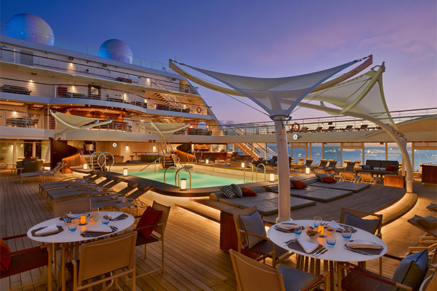 Pool deck on Seabourn Encore at sunset