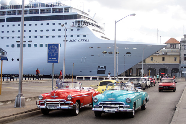 MSC Opera docked in Havana, Cuba, with famous cars in the foreground