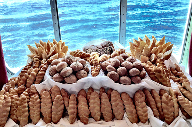 Loaves of bread onboard a Kosherica cruise, with ocean in the background