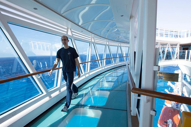 Passenger walking along the SeaWalk on Regal Princess