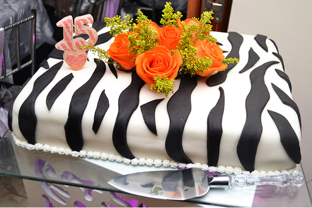 Quinceanera cake with zebra fondant and candles