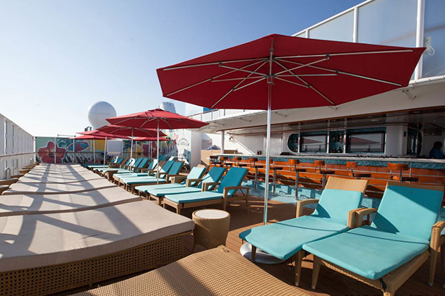 Vibe Beach Club loungers and umbrellas on Norwegian Getaway