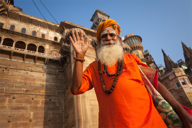 Greetings from an unidentified Hindu sadhu holy man, standing on the ghat near the Ganges river in Varanasi, India