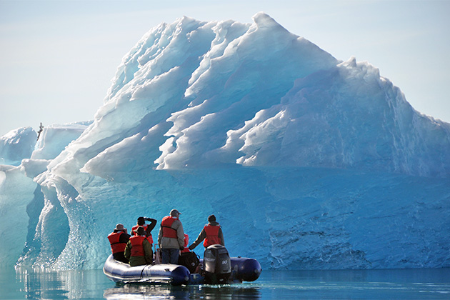 Skiff exploring glacial ice in Alaska