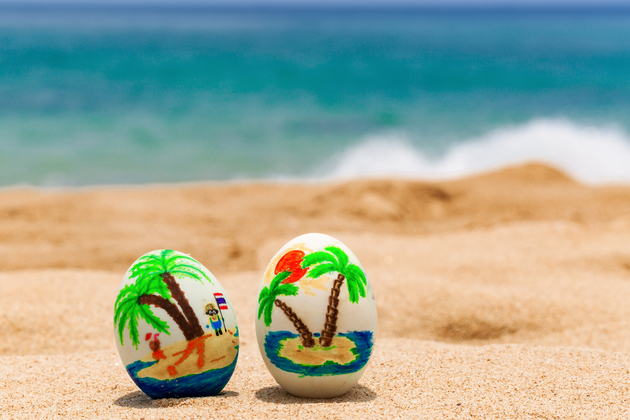 Easter vacation cruises - Easter eggs, painted with palms on the ocean beach