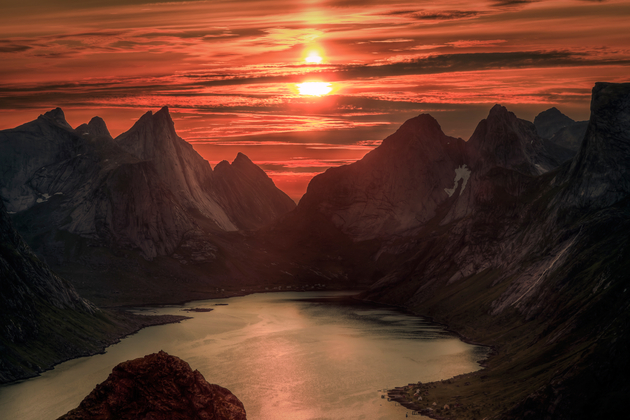Midnight sun over Reinebringen. Summer in the Lofoten in Norway