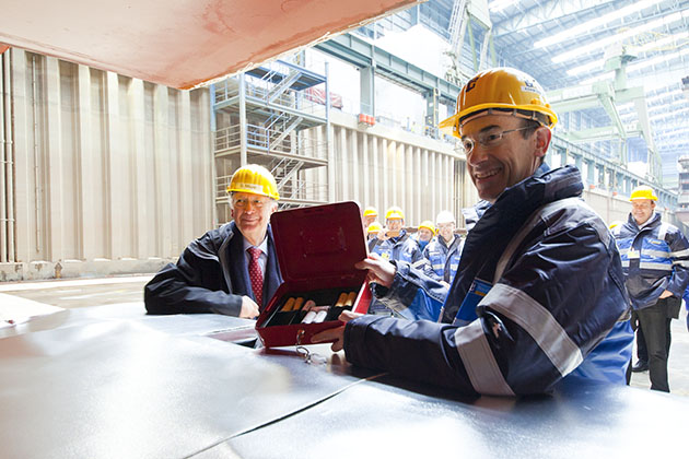 Freshly minted coins being placed at a Royal Caribbean keel laying ceremony