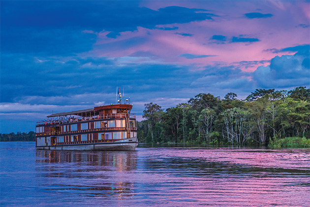 Delfin II on the Amazon River at sunset