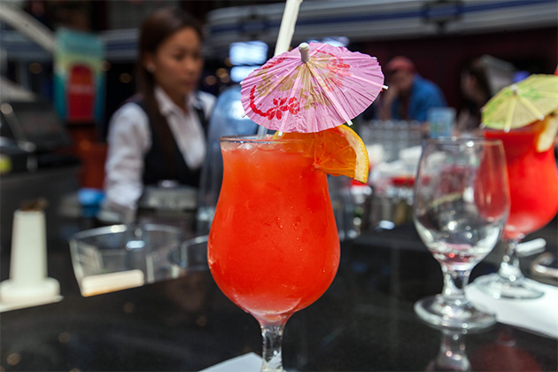 Close-up shot of a fruity red drink at Carnival Fantasy's Atrium Bar