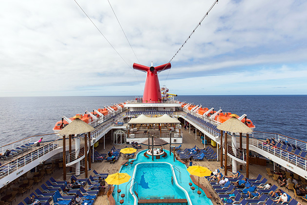 Aerial view of Carnival Inspiration's pool deck with the ship at sea