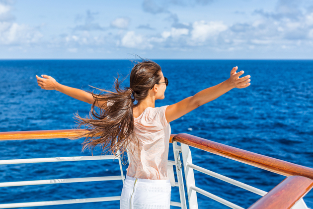 Woman enjoying travel vacation at sea