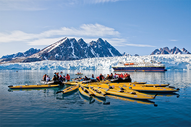 National Geographic Explorer passengers kayaking near Spitsbergen Island