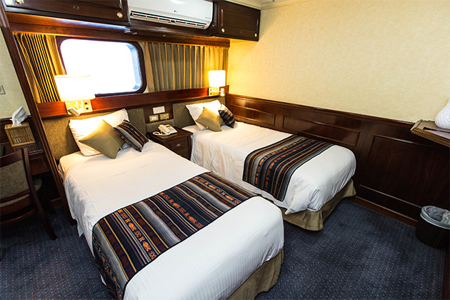 Shot of twin beds in The Category 4 Cabin on National Geographic Islander