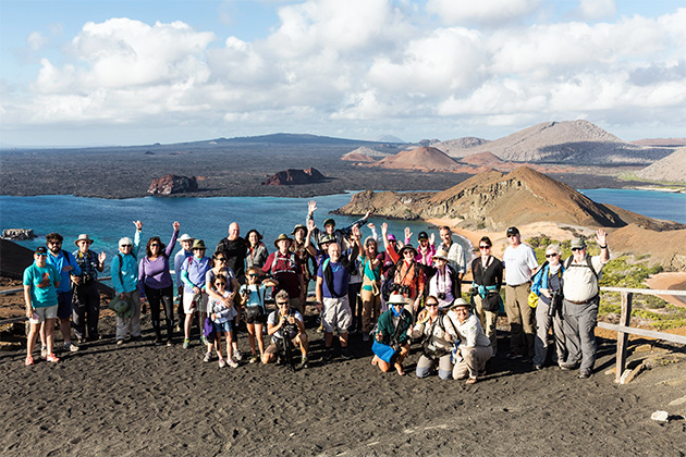 Group shot of Lindblad passengers with Galapagos view in the background