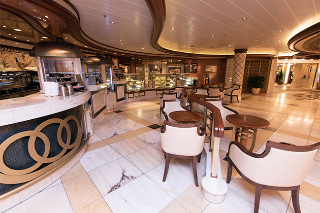 View of the International Cafe serving stations and seating areas on Royal Princess
